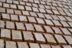 Clay bricks drying along the path leading to Pikuylluna.